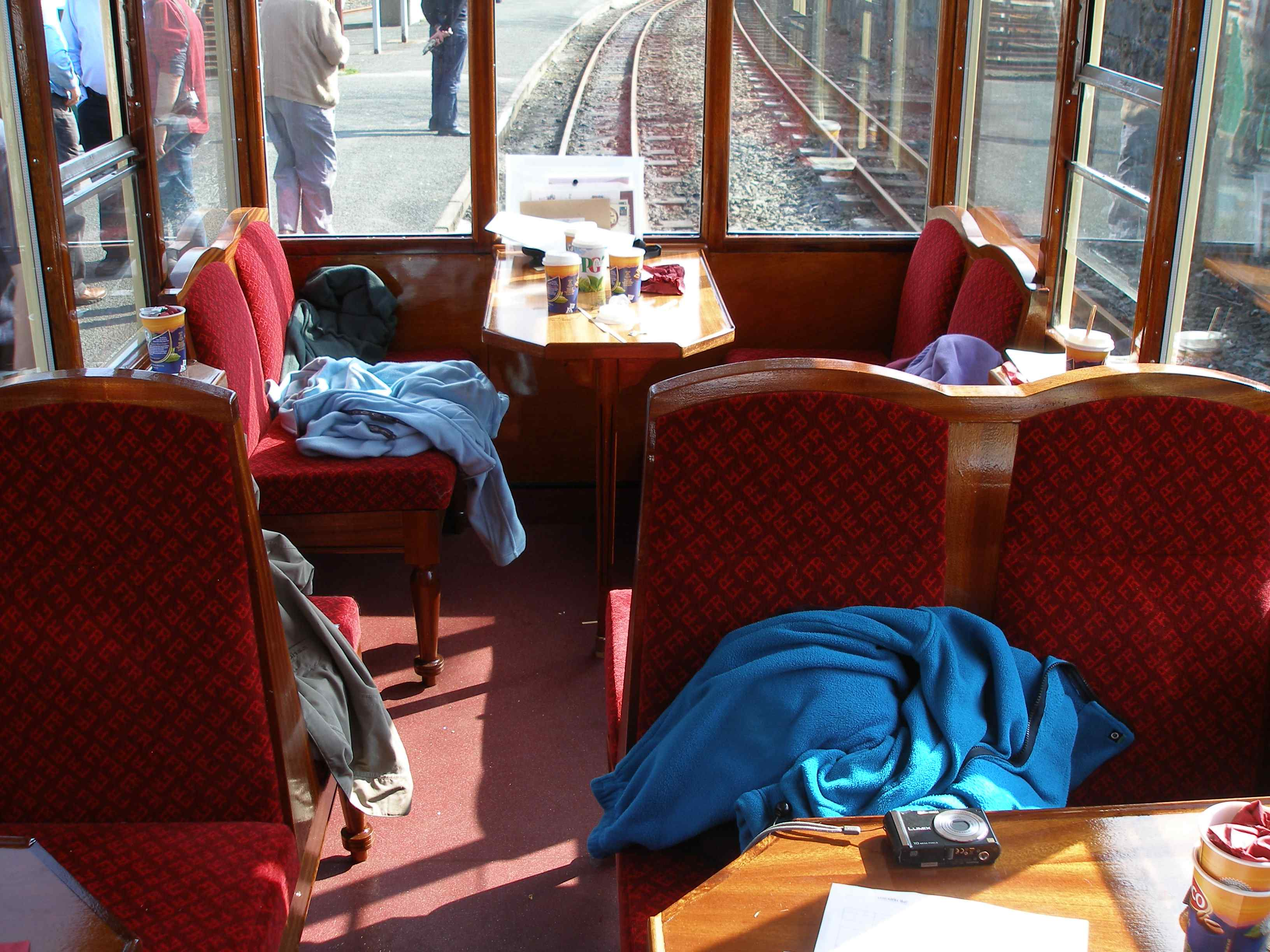 The interior of the newly-commission 123 at Blaeunau Ffestiniog. Note how conventional bench seats have now been fitted, replacing the original swivel chairs, and how the end seats face each other. The old louvre windows (originally designed for caravans and very difficult to keep clean with both coal and oil fired locos) have been replaced with neat drop lights.