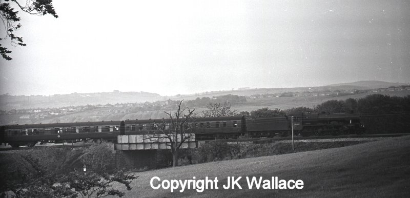 LMS (BR) Stanier Jubilee 45581 'Bihar & Orissa' climbing out of Burnley towards Copy Pit with 1X32 return advertised execursion Blackpool North – Leeds City at 19.21 Whit Monday 30 May 1966.