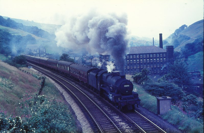 Stanier Jubilee 45694 'Bellerophon' is heading towards Blackpool on a Summer Saturday in 1966.