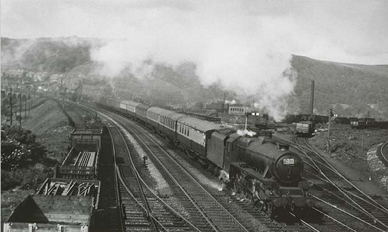 Black 5 approaches Hall Royd Road bridge with a train of Gresley carriages in the early 1950s red and cream livery