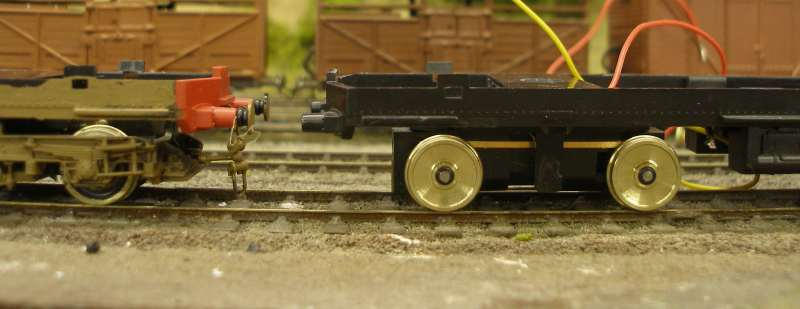 Hornby Class 110 DMU re-motoring project: new chassis with both Black Beetles fitted, buffered up to original chassis showing difference in ride height.