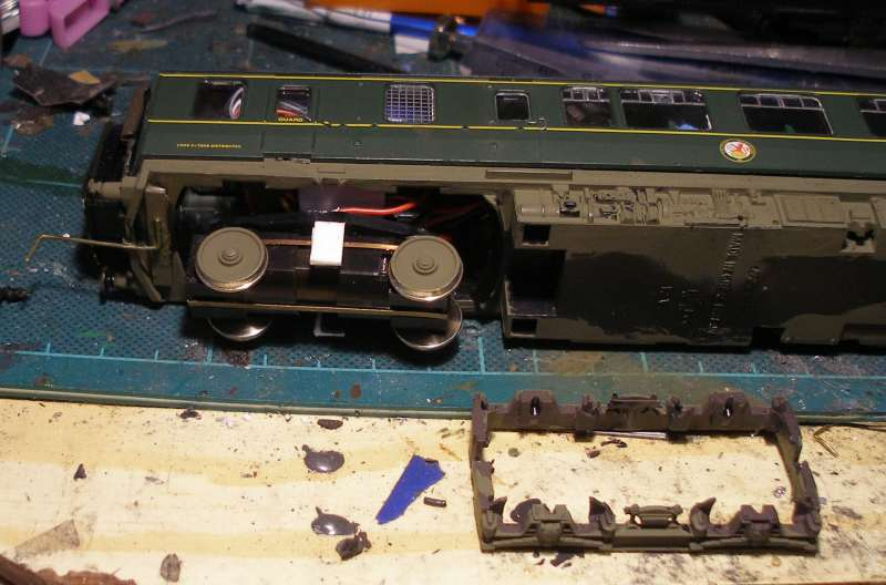 Hornby Class 110 DMU re-motoring project: plastic strips added to Black Beetle frame supports ready for the Hornby side frames to be added