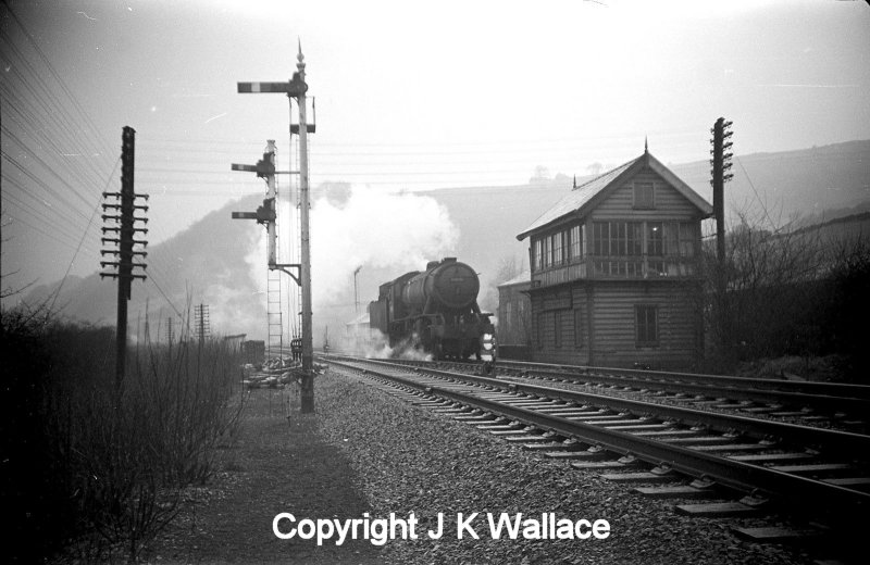 A WD Austerity 2-8-0 drifts past Dover Bridge signal box in the Calder Valley light engine in the early 60s