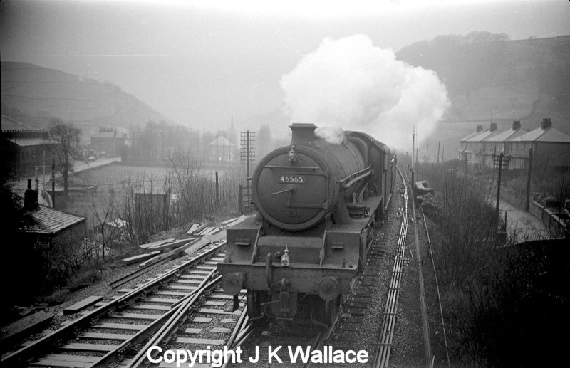 LMS Jubilee 45565 'Victoria' approaches Dover Bridge signal box with an eastbound passenger train in the early 1960s.