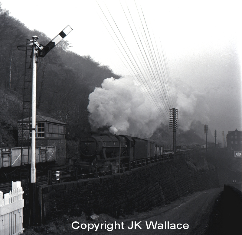 Stanier 8F 48319 passing Eastwood signal box near Todmorden on a westbound pickup freight 10.50 a.m. on Saturday 28 December 1963.