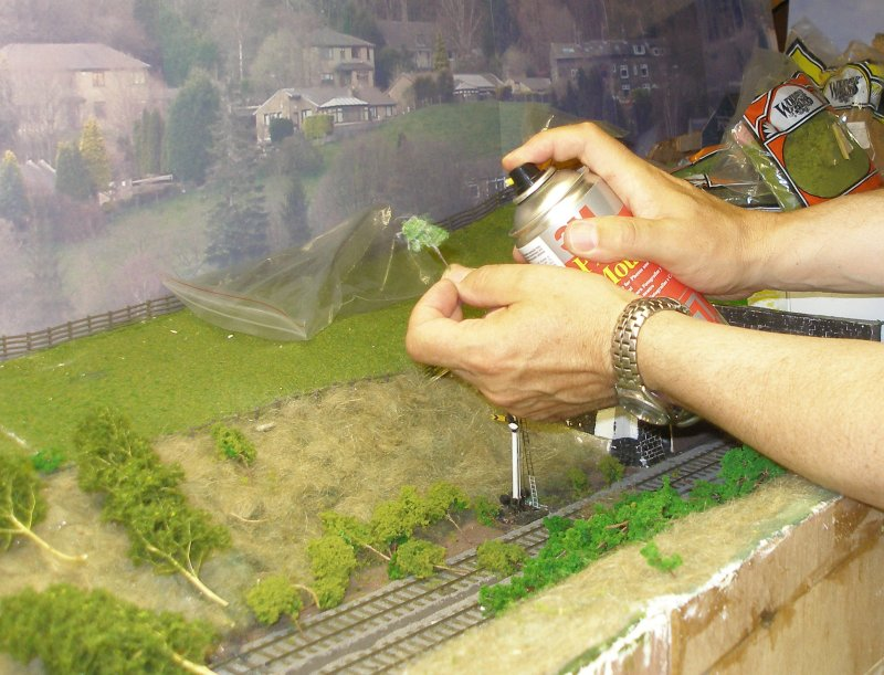 Hall Royd Junction (the model) showing the application of flock to the Seafoam trees, with the 'tree' being sprayed with Spraymount.