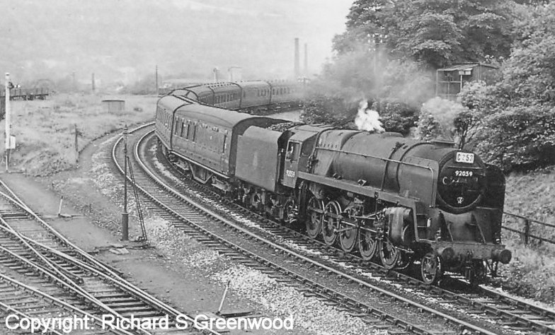 BR Standard 9F 92059 wheels a Saturday's only service from Blackpool and heading for Yorkshire under Hall Royd Road bridge on 6 August 1960.