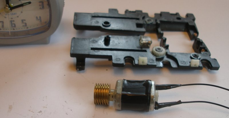 Bachmann Jubilee with Buelher motor conversion to DCC. There are two small springs that connected with the motor terminals, and these should be removed. The soldered terminals are now covered in insulation tape or similar.