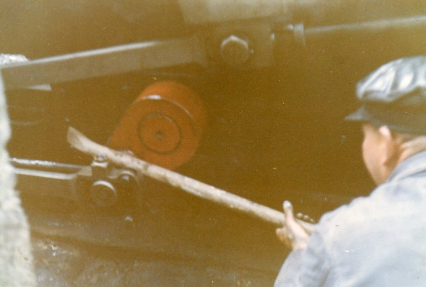 Driver and General Manager Alan Garraway sets about removing Linda's coupling rod at Tan-y-Bwlch. Sunday 7 August 1966.