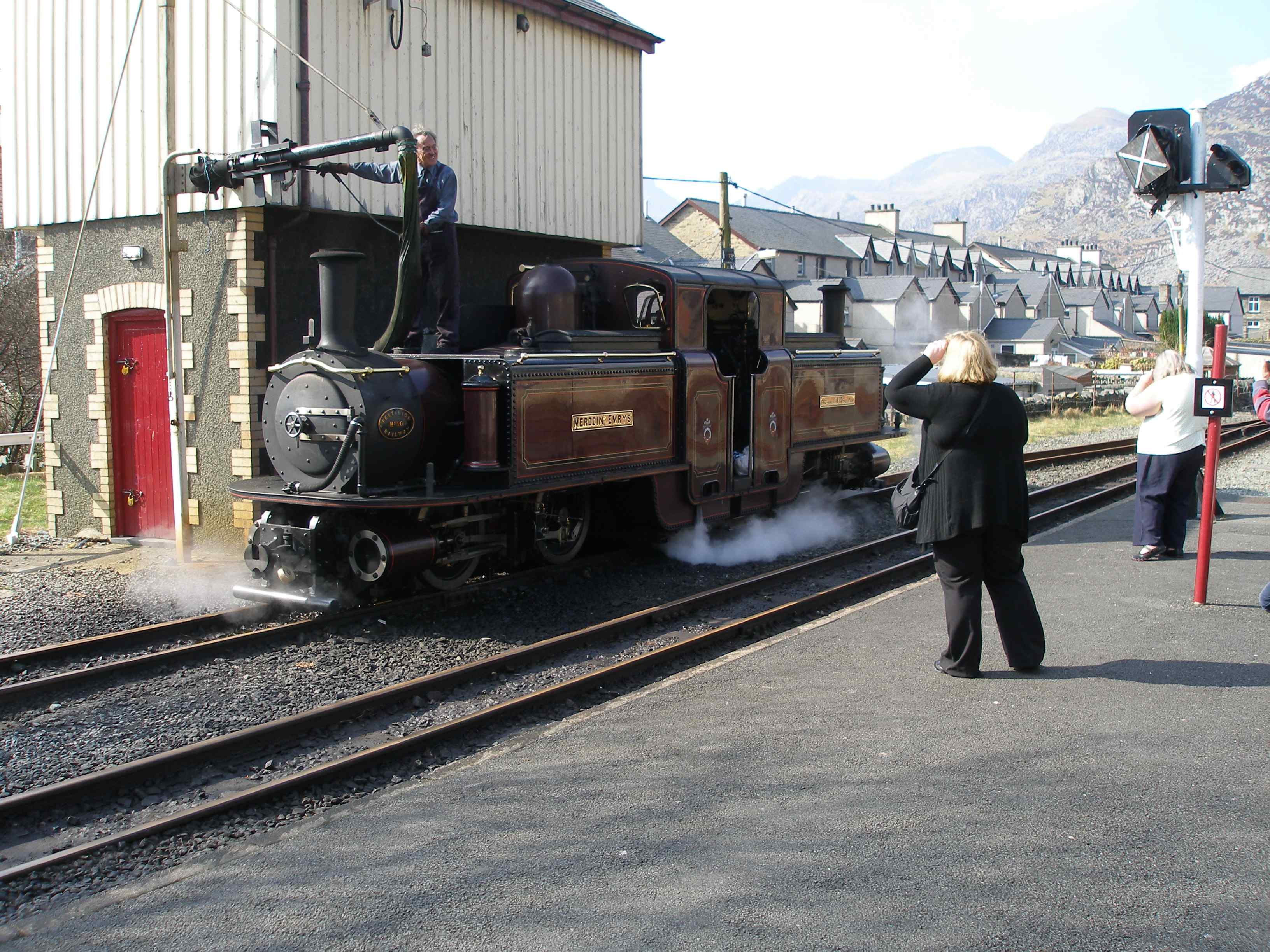 'Merddin Emrys' takes water at Blaenau Ffestiniog. Note the wooden cladding to protect the tank at this exposed location.