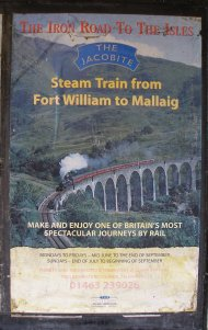 Care-worn poster advertising West Coast Railways train on the 'Iron Road to the Isles' at Glenfinnin 18 October 2013. Services in the year of publiction ended in September.