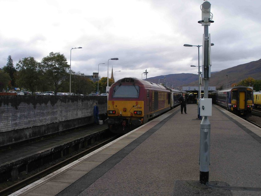 67009 stands at Fort William with the stock of the southbound sleeper.