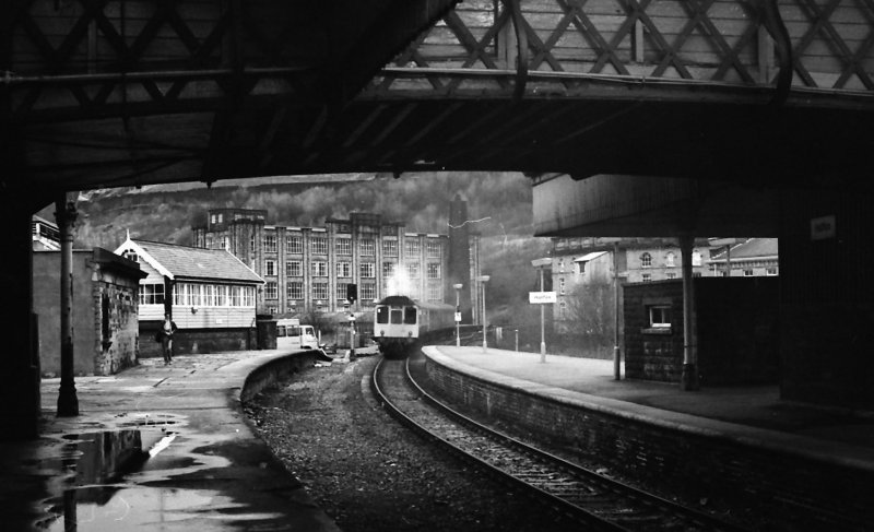 Class 110 3-car Calder Valley unit leaves Halifax whilst working the 10.45 Blackpool-Leeds service on a wet 2 January 1987.