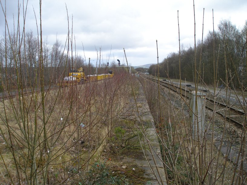 Rose Grove Station looking north towards Gannow Junction with the permanent way train stabled in the loop in readiness for the major relaying of the Gannow Junction - Colne railway line on Sunday 23 March 2014.