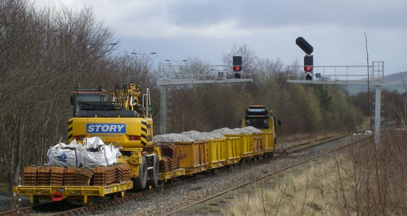 The permanent way train stands ready to relay the Colne branch with metal sleepers to hand.