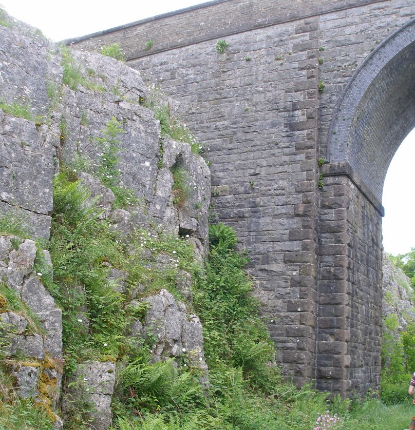 Tall bridge in rock cutting on the ex-LNWR line from Boxton to Ashbourne.