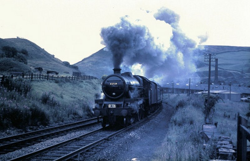 Stanier Jubilee 45739 'Ulster' heading away from Todmorden and Stansfield Hall Junction up the Cliviger Gorge towards Copy Pit and Burnley in 1966 with excursion 1M07.